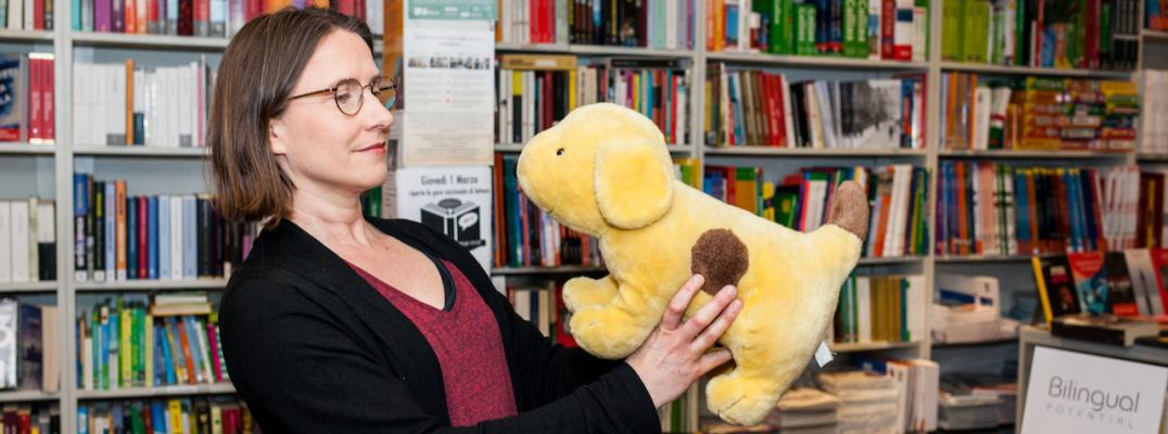 Bilingual family specialist Soile Pietikainen and the toy dog at bookshop